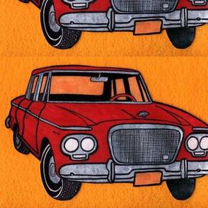 red Studebaker Lark (twin headlight era) on orange background)