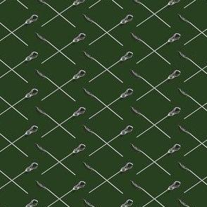 Hunter Green Crossed Lacrosse Sticks
