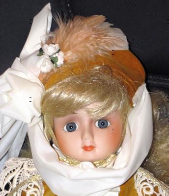 Doll dressed in Gold Colored Velvet