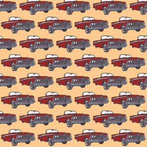 red 1959 Corsair convertible on peach background