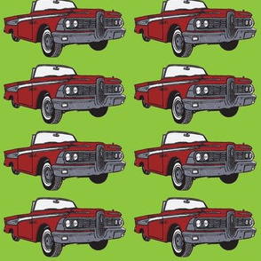 Giant 1959 red Edsel Corsair convertible on green background