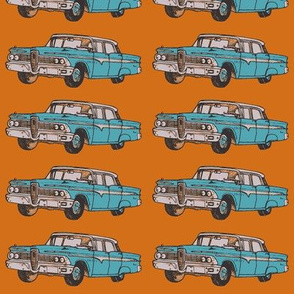 aqua 1959 Edsel Ranger on rust background