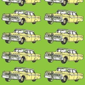 Yellow 1959 Edsel Ranger on green background