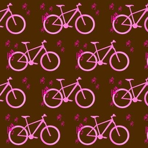 Pink bike and music on brown background