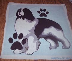 Landseer Newfoundland dog with paw prints