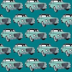 green Studebaker Lark on teal (diagonal rows)