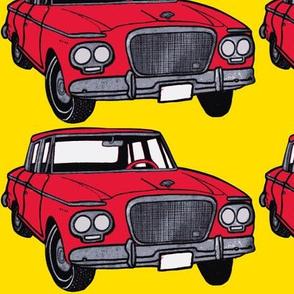 big red 1962-1963 Studebaker Lark on yellow background
