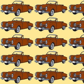 brown 1950 Studebaker convertible bullit nose on yellow