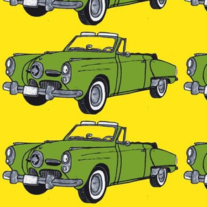 Huge, pea soup green1950 Studebaker convertible bullet nose on yellow