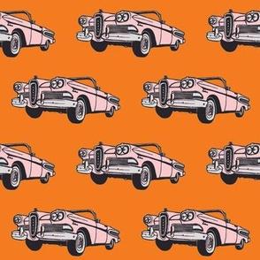 Pink 1958 Edsel Citation on orange