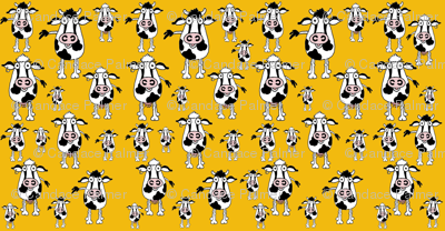 Black and white cows on a yellow background.