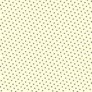 Coffee bean dots on cream