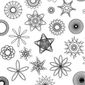 black and white gear-drawn spirals