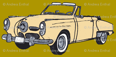 Cream 1950 Studebaker convertible on mustard green background