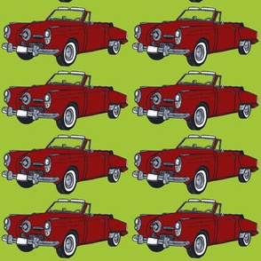 red 1950 Studebaker convertible on lime background