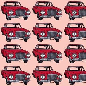 red twin headlight Studebaker Lark on pink