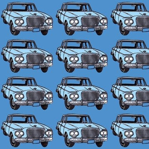 light blue double headlight Studebaker Lark on med blue