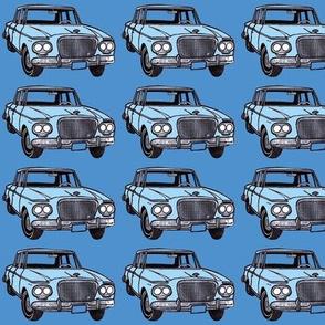 light blue double headlight Studebaker Lark on med blue
