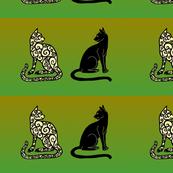 black cat spiral cat on green