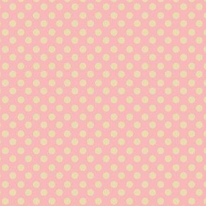 yellow polka dots resting on pink