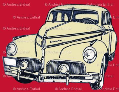 cream 1940-41 Studebaker on red background