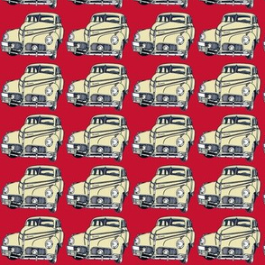cream 1940-41 Studebaker on red background