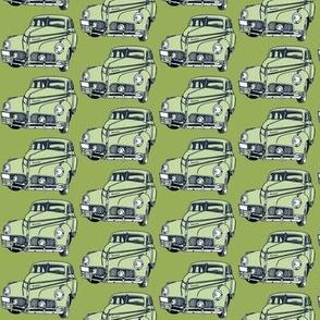 pale green 1940-41 Studebaker on olive background