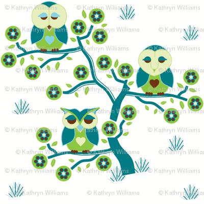 Sleepy Owls sitting in a tree