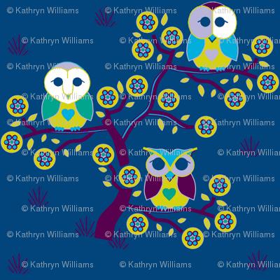 Wide awake owls on a blue night