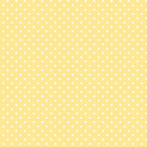 White dots on a yellow background