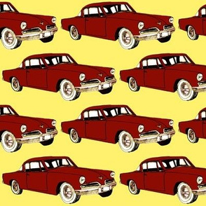 Big red 1953 Studebaker on yellow background