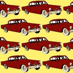 Big red 1953 Studebaker on yellow background