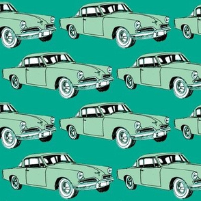 Big aqua 1953 Studebaker on teal background