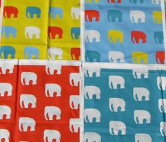 Multicoloured elephants on teal