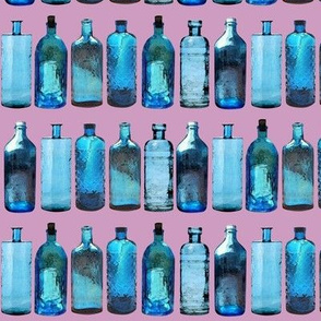 blue glass bottles on pink