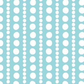 white on turquoise pebbles