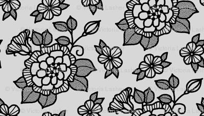 Black flocked velvet flower on silver