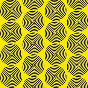 Black spirals, yellow background