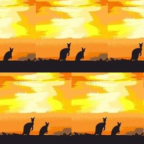 kangaroos crossing the desert at dusk