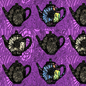 black teapots on purple