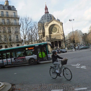 Cyclist and bus at St. Augustine, Paris