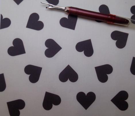 Dark chocolate hearts on cream