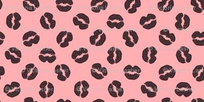 Dark chocolate kisses on strawberry cream