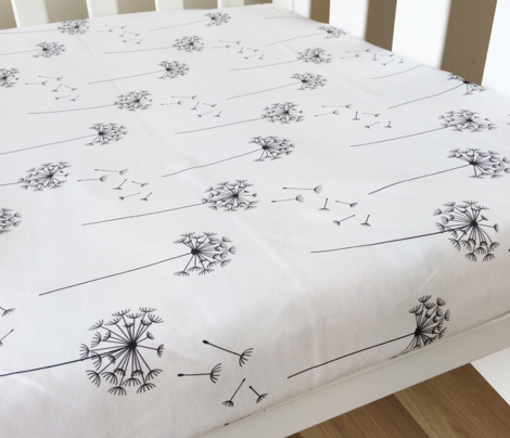 black + white blowing dandelions - horizontal