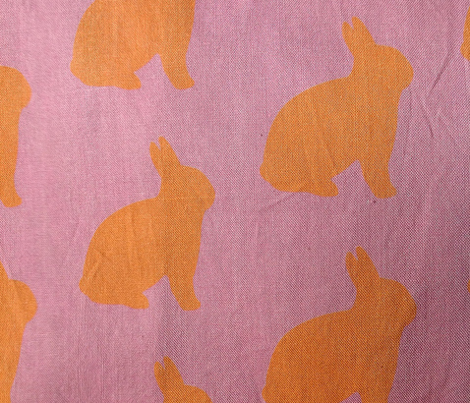 Orange bunnies on pink