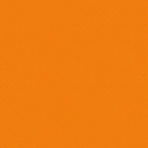 Orange/red solid