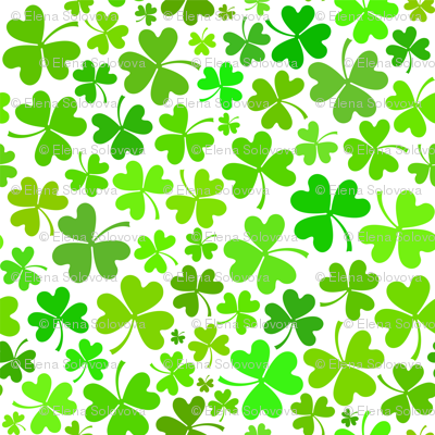 Green clovers on white background