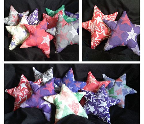 Patterned stars purple, red and white on grey