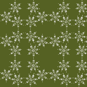 snowflake arrangement on green grass