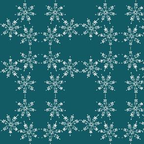 snowflake arrangemet on teal blue sky